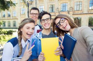 Students posing outside the university