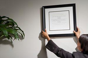 Employee hanging her certificate