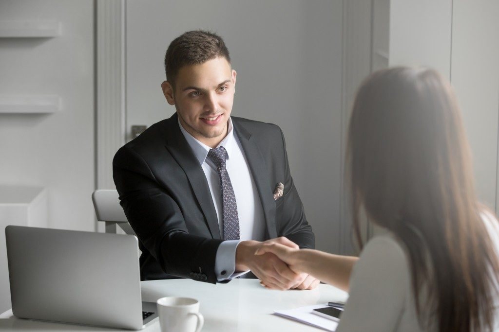 man shaking the hand of a client