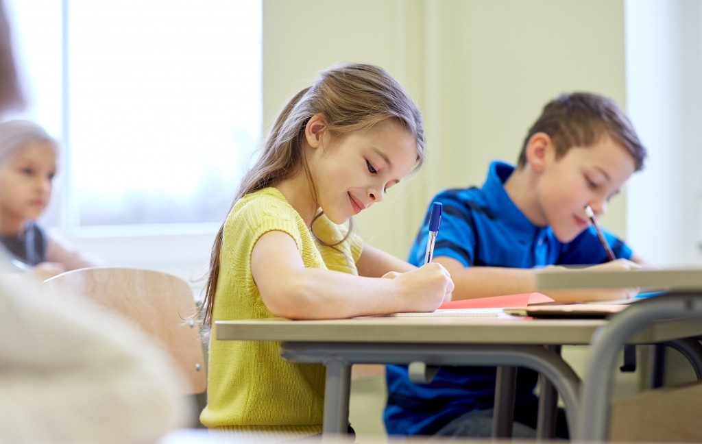 students writing in their class