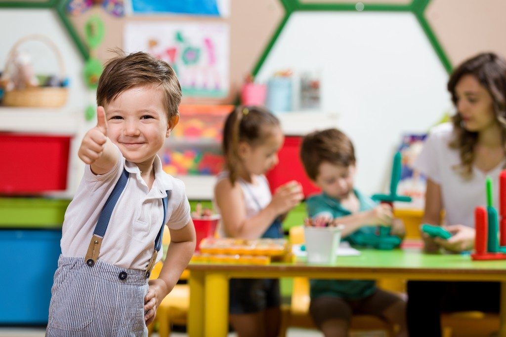 Preschool children and teacher in the classroom