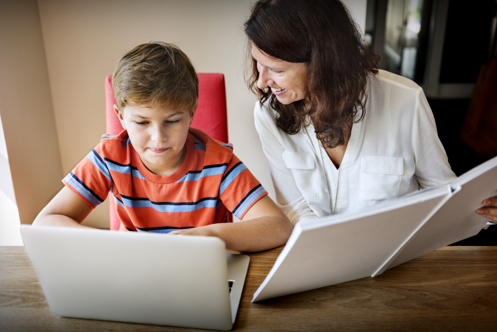 mother and son browsing the internet